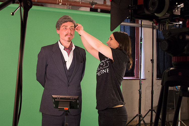 Behind the scenes: A master at work. Producer Lauren Prendergast attends to a focused Sir Dickie Benson