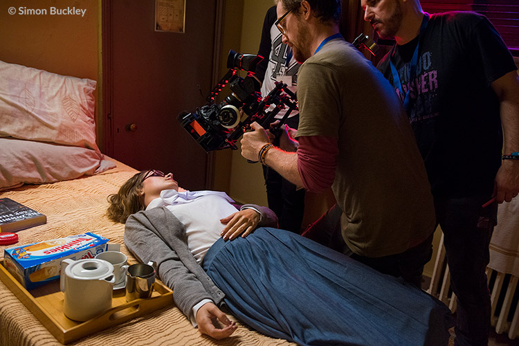 Cinematographer Mat Johns getting a total upper body workout while shooting a close-up of Lauren Ashley Carter