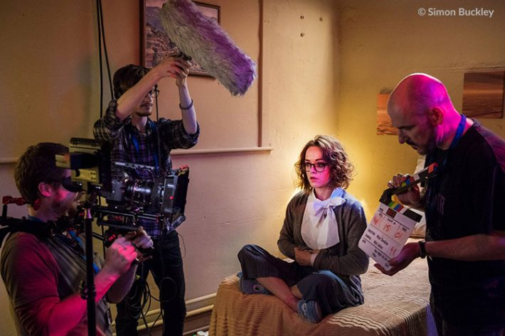 [L to R] Cinematographer Mat Johns, sound recordist Thurston Thomson, Lauren Ashley Carter as Martha Swales and director Pete Tomkies filming Once Bitten... at A4 Studios in Altrincham