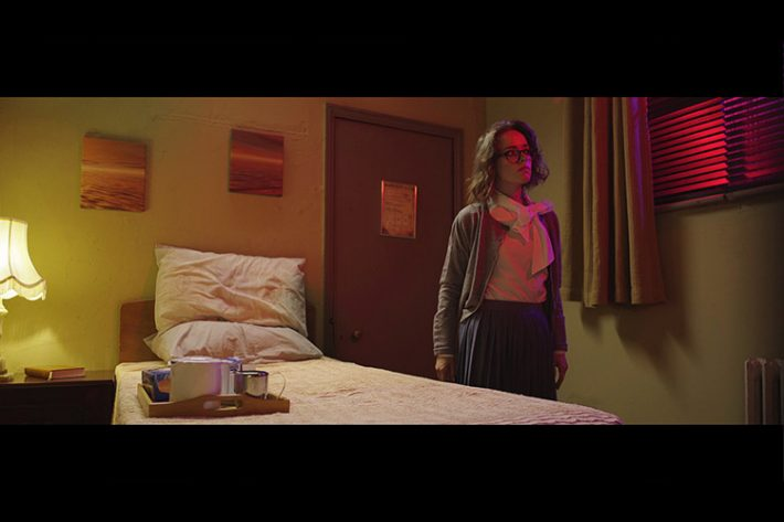 Lauren Ashley Carter as Martha Swales investigates strange happenings in her hotel room