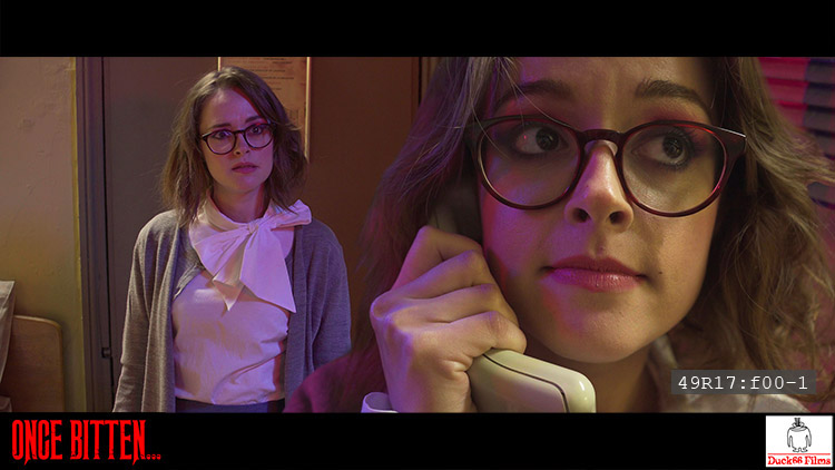 Timecoded frame from Once Bitten... showing both the roles of Martha Swales and Dredvoka being played by Lauren Ashley Carter