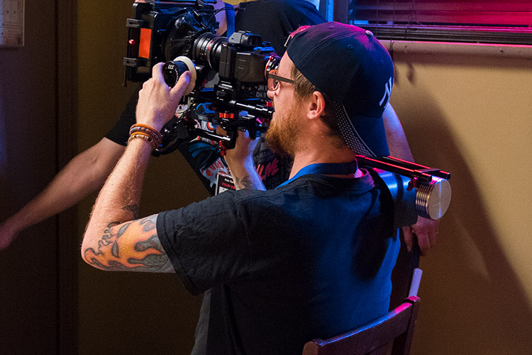 Cinematographer Mat Johns at work on set for Once Btten...